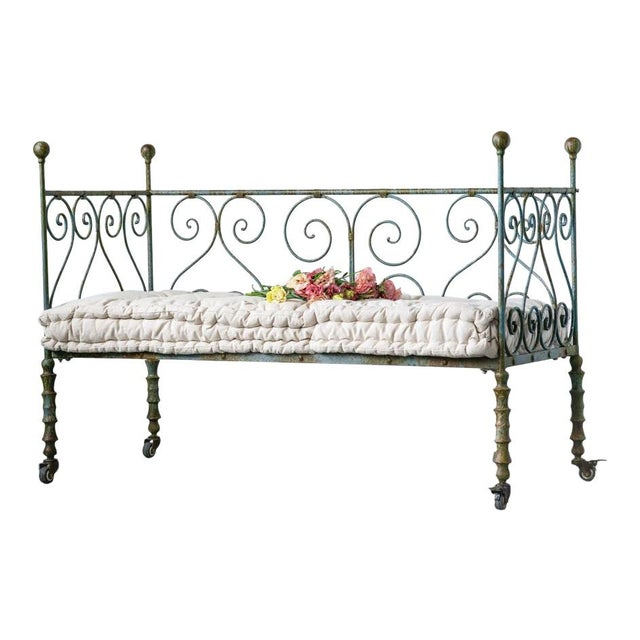 Classic style metal day bed in black patina with castor wheeels. Upholstered cushion fabric patterned cuhsion seat. The...