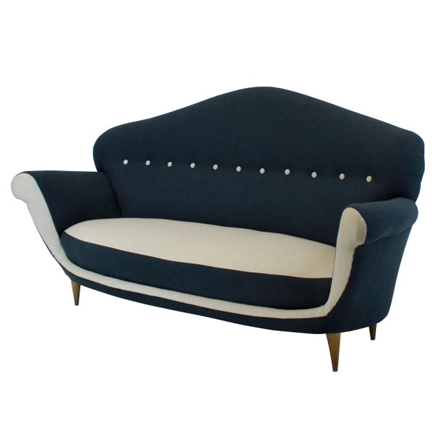 A large Italian sculptural settee of interesting design. Newly upholstered.