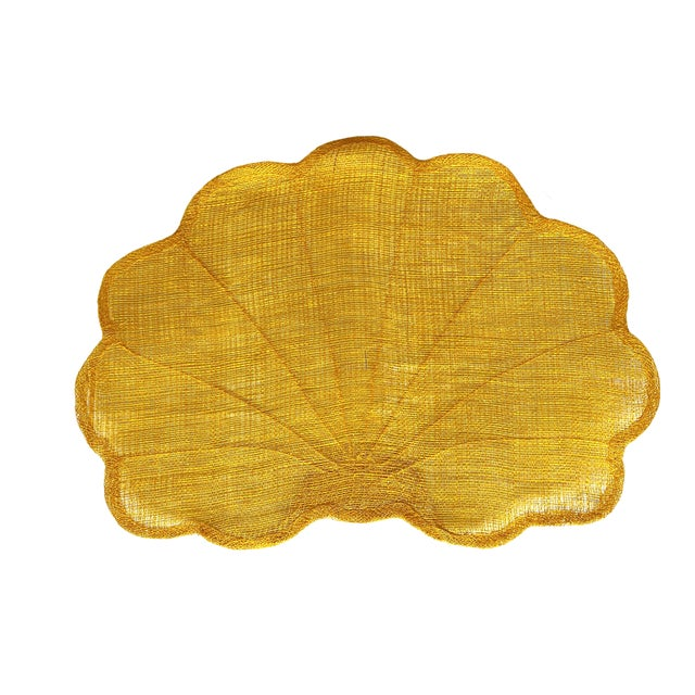Vintage but appear unused placemats in the shape of scallop shells. Made of abacá, a banana-plant fiber similar to hemp....