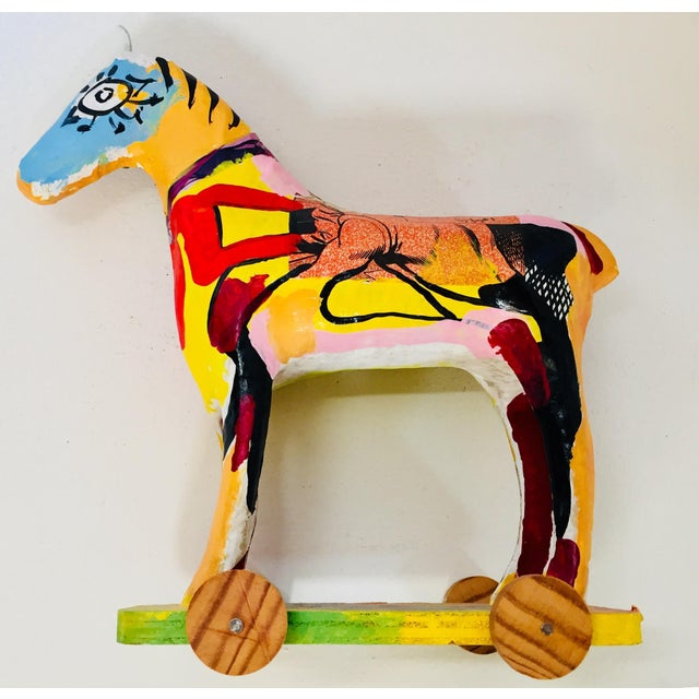Papier mâché sculpture of a horse on stand, hand painted in polychrome bright colors with Arabic writing. Great to use on...