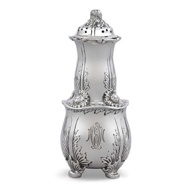 This fine set of four Tiffany & Co. sterling silver salt and pepper shakers feature the coveted Chrysanthemum pattern....