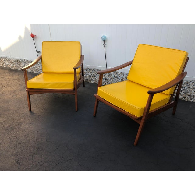 Mid century danish modern pair of beechwood lounge chairs with yellow vinyl cushions. Chairs have been completely...