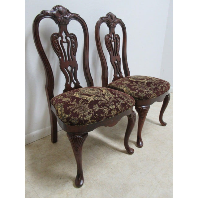 """A pair of Thomasville dining chairs. Measurements ( L x W x H) 22 x 22.5 x 41.75"""" Seat height 18.5"""". Please see photos as..."""