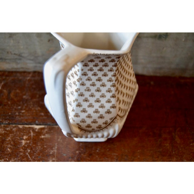 English Ironstone pitcher with whimsical clover pattern and molded decoration. Made with transferware ceramic. Done in the...