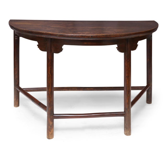 Large Chinese elm demilune console, circa 1910-1930. Remnants of original brown paint and lacquer finish.