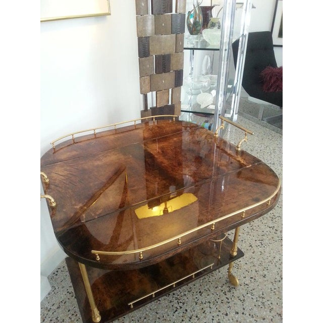 This stylish and chic bar cart was created in the 1950s-1960s by the Italian designer Aldo Tura and the piece is...