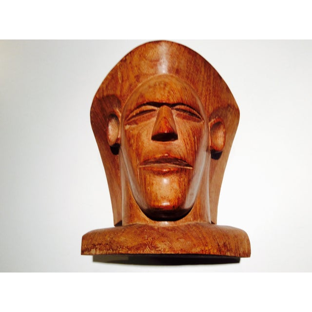 A powerfully carved wood bust from Fiji sculpted rrom the traditional hardwood Vesi, which is a very hard and heavy wood...