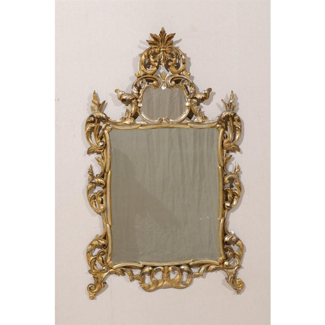 An Italian Early 20th Century Gold and Silver Gilt Mirror with Richly Carved Wood with Old Mirror.