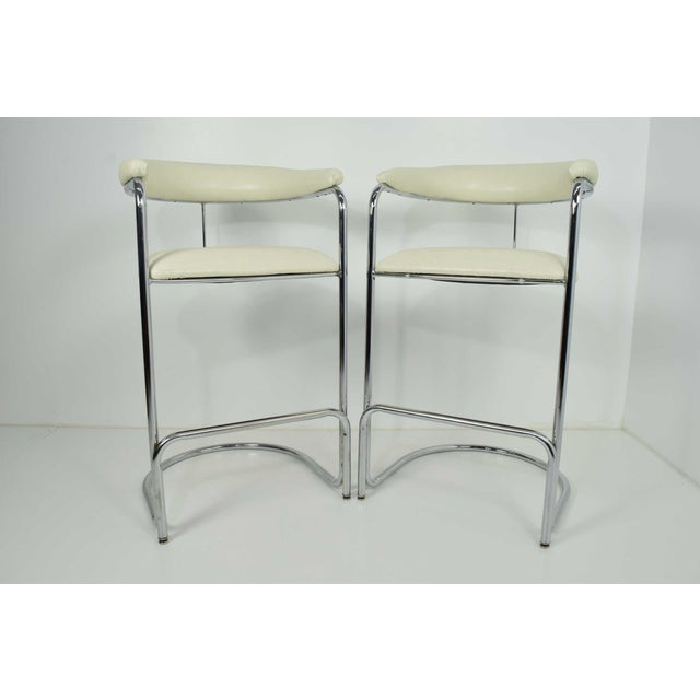 This is a great pair of barstools very much like Thonet and likely they are Thonet. They have been reupholstered in a...