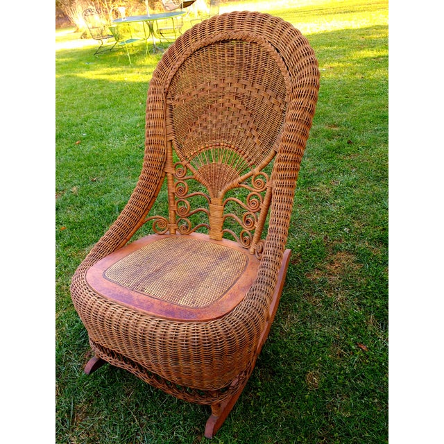 Here is a fabulous turn of the century antique wicker rocker in excellent condition for its age. Please see all photos --...