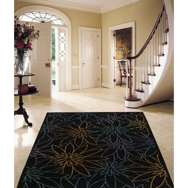 Hand tufted made of 100% pure lamb's wool. Easy care and maintenance. The timeless style of this rug will give your room...