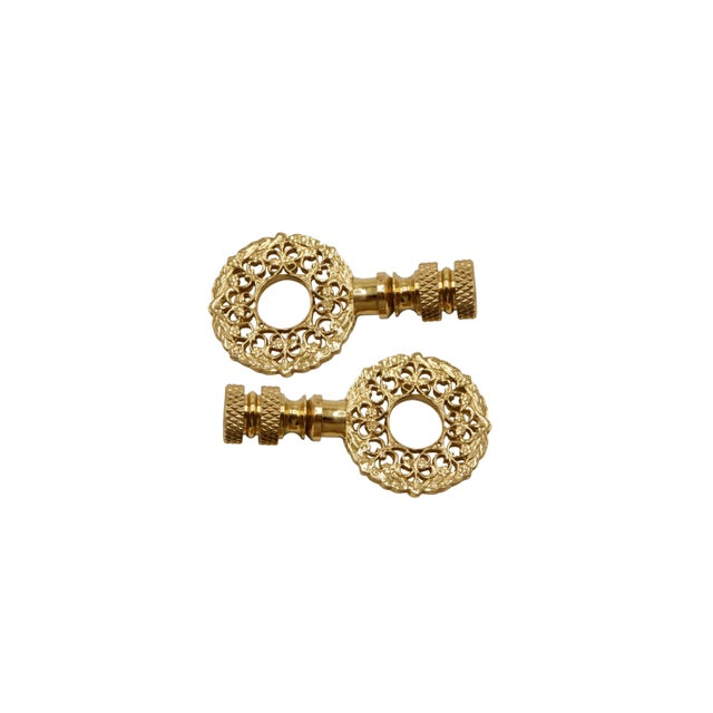 A pair of brass wreath lamp finials. Fits a standard size lamp harp. Dimensions per finial. We have more lamp finials...