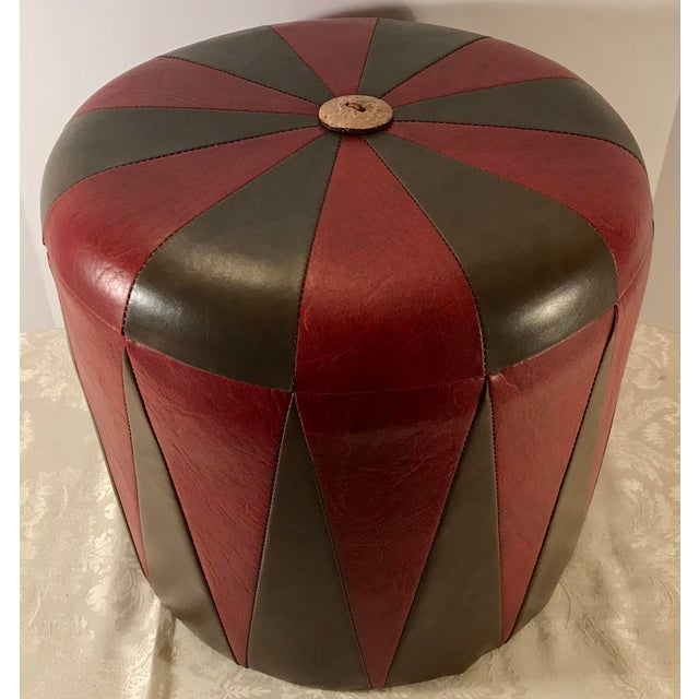 Nice round vintage leatherette footstool or ottoman featuring a two tone design - red and brown.