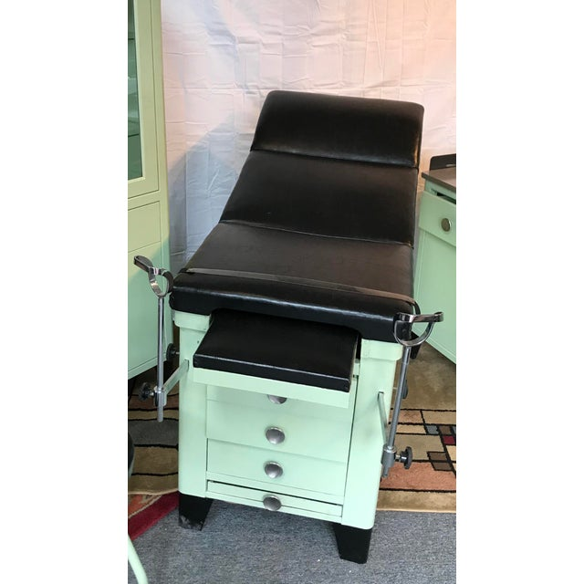 An amazing medical examination table in excellent condition. Part of a 5 piece set that I have listed.