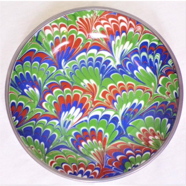This is a hand painted porcelain bowl, made for Neiman Marcus in a marbleized design in vibrant reds, blues and greens....