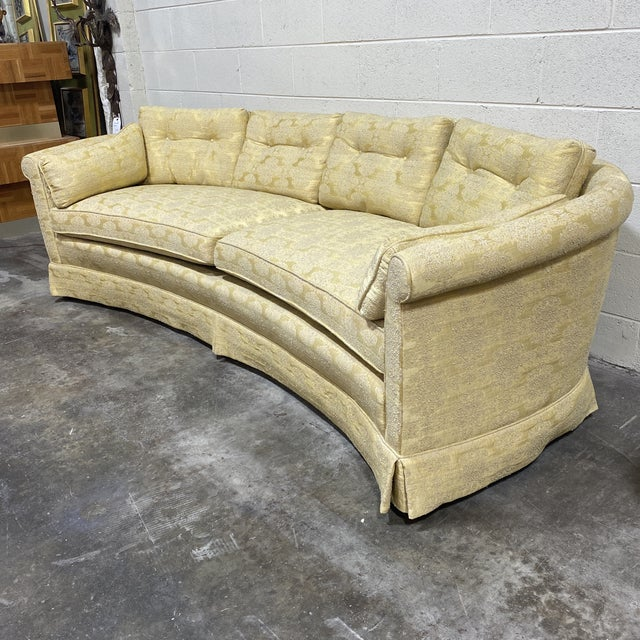 Beautiful curved Hollywood Regency pale yellow sofa by Henredon. It's not hard to believe that a Henredon piece would hold...