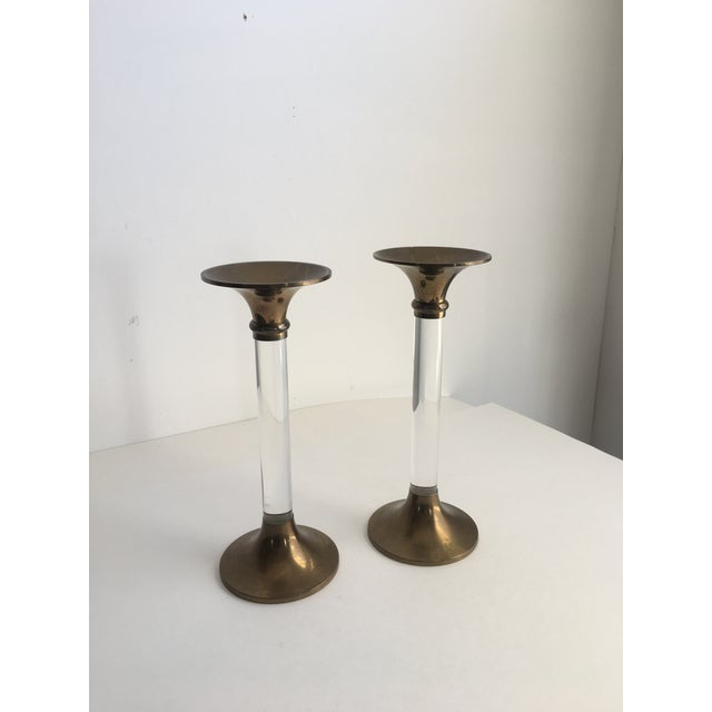 A fantastic pair of vintage brass and lucite candlesticks. The simple shape of these make them suitable for many different...