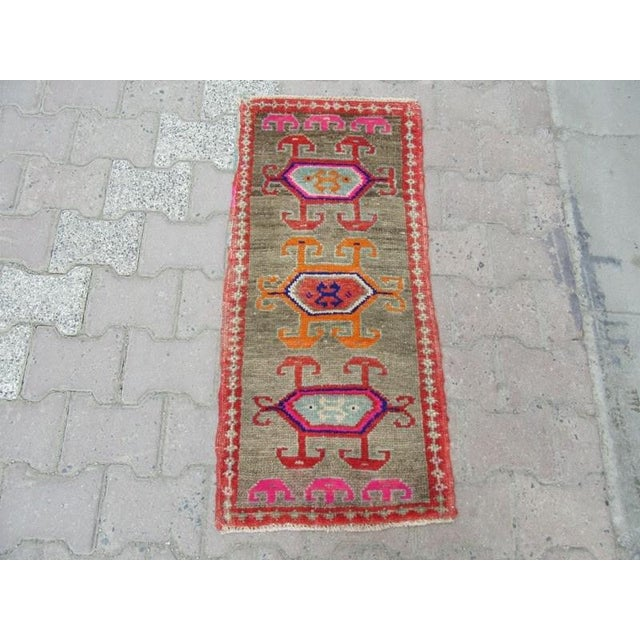 Handknotted Vintage rug from Hakkari region of Turkey. Approximately 45-55 years old.In very good condition.