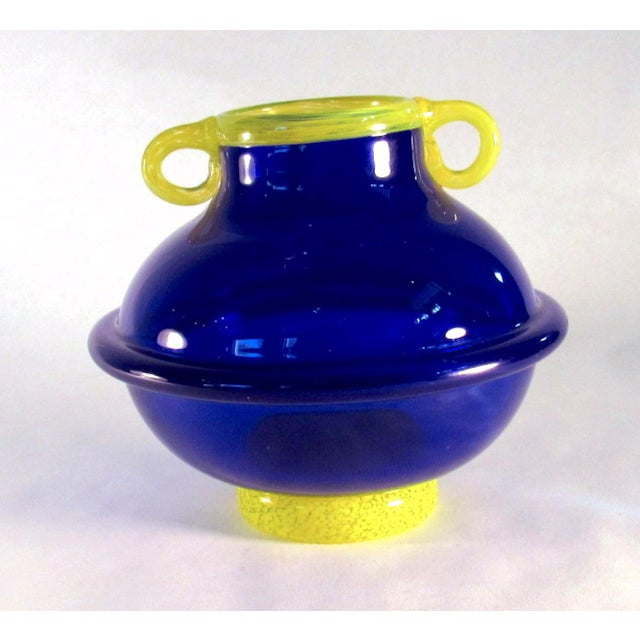 This listing is for a hand blown cobalt and yellow art glass amphora style vase. This adorable little vase is signed by...