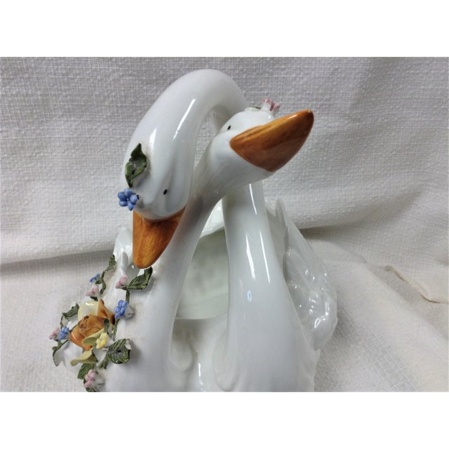 Capodimonte Hard to find example of an entwined pair of swans with floral and vine trim. They form what could effectively...