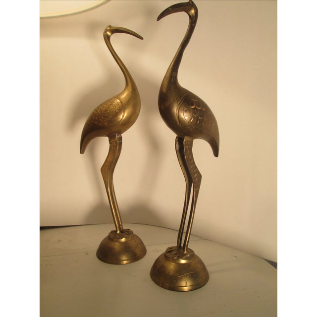 Beautiful pair of mid-century solid brass cranes. Circa 1970. Would look great on a mantle or any accent table!