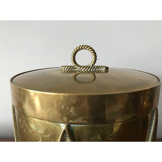 An unusual Italian brass ice bucket-crafted for Bloomingdales and shaped like a drum.