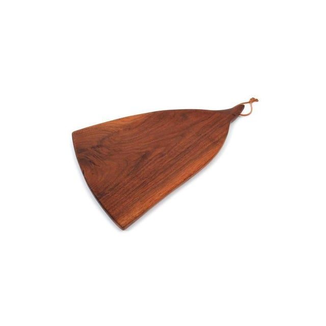 Rare cutting board in walnut by exhibited studio furniture maker Dirk Rosse. Sculptural and considered form. Rosse was...