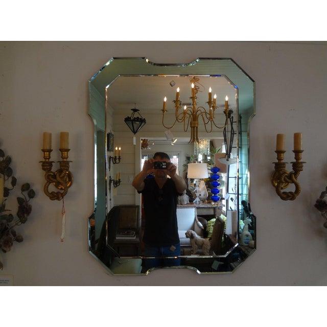 Italian Fontana Arte inspired mid-century modern beveled rectangular mirror with a soft green border, circa. 1960 This...