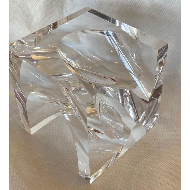 Lucite cube sculpture by Alessio Tasca for Fusina. The sculpture is a cube with deep scoops taken out of adjacent sides....