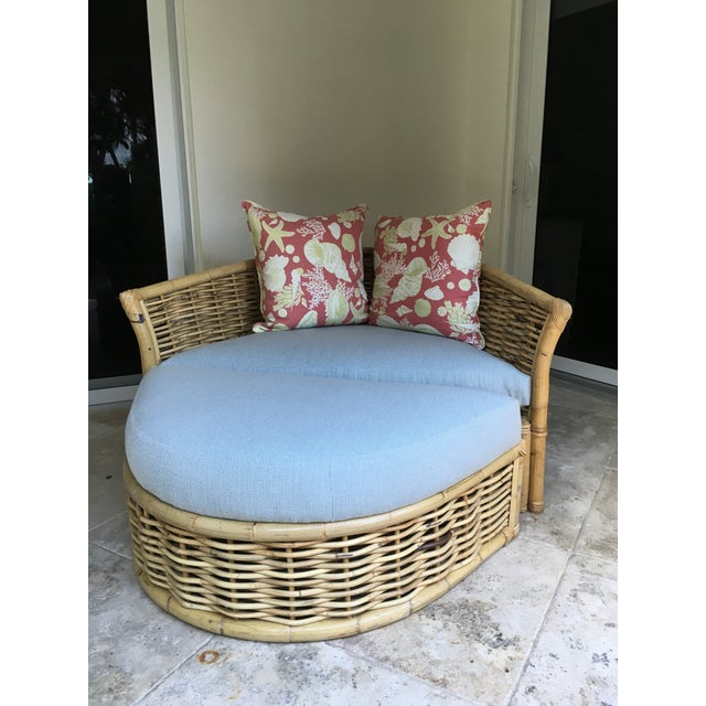 A very cool, vintage, one of a kind, large rattan lounger with ottoman. It is solid , in great shape and just...