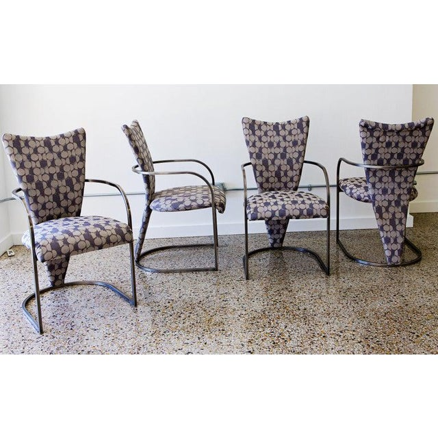 Dining chairs, set of four, by Design Institute America. Midcentury Classic. Brushed aluminum frames with new cushioning...
