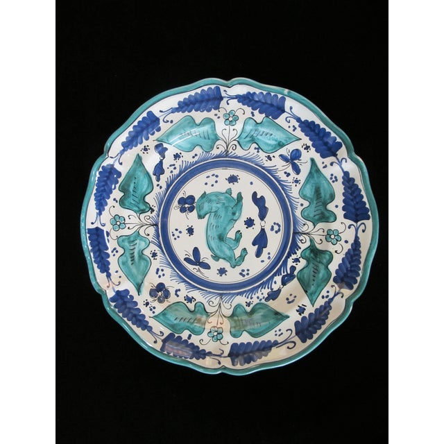 Absolutely darling Majolica plate set by Italian designer Assisi. Bright tones of blue and green on white with flowers and...
