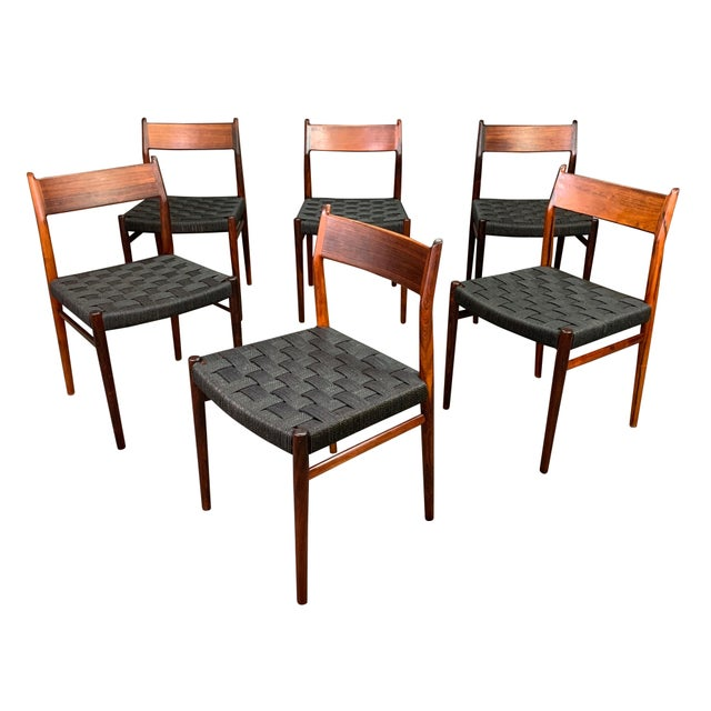 Here is a rare set of six Scandinavian modern chairs Model 418 in Brazilian rosewood designed by master Arne Vodder and...
