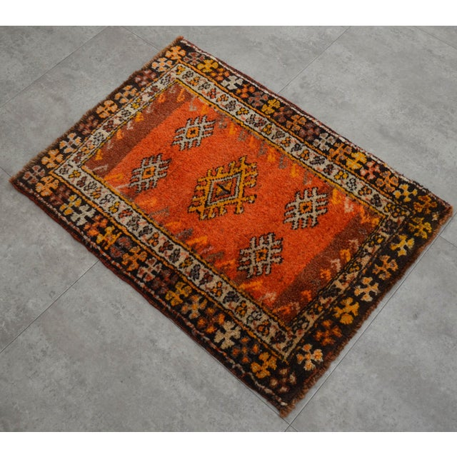 a Vintage Turkish Small yastik rug, strong red orange background color yastik rug perfect for entryway, bath or in front...