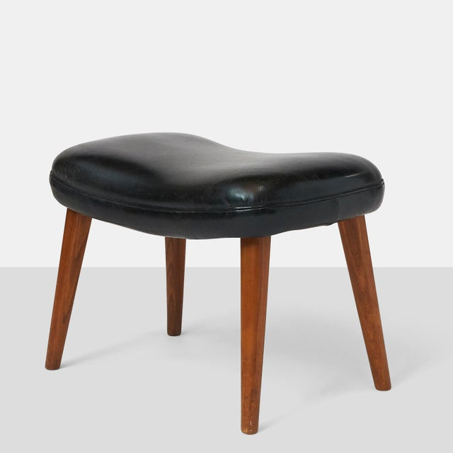 "Ib Madsen & Acton Schubell ""Pragh"" Foot Stool A rectangular shaped foot stool with black leather cushion seat and 4..."