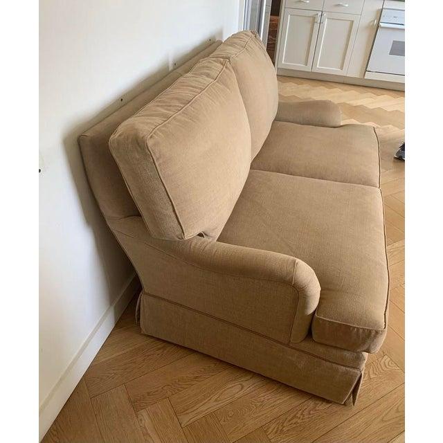 Bench made custom sofa. Upholstered in Romo Linera fabric. Bridgewater arm, nailhead trim