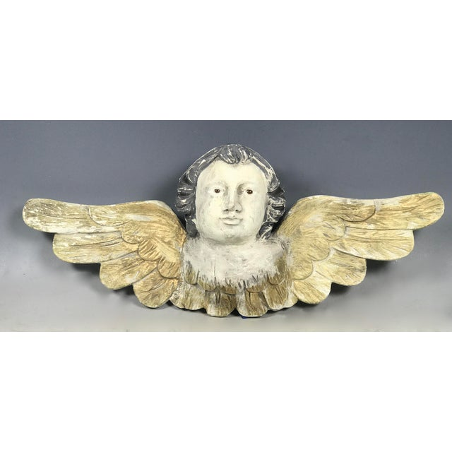 Vintage Polychromed Carved Wooden and Gesso Paint Angel with Wings Dimensions: 16.25ʺW × 4ʺD × 6.25ʺH Period: 1980s Item...