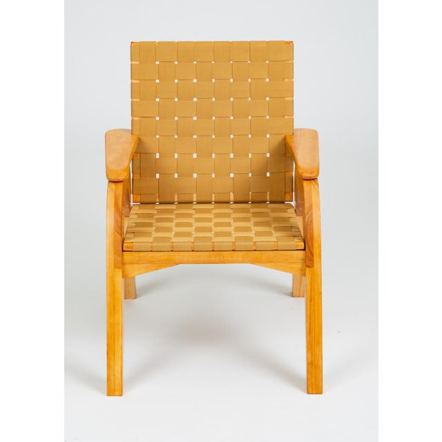 A custom studio craft lounge chair with a stylistic nod towards Klaus Grabe's iconic pre-fab plywood furniture....