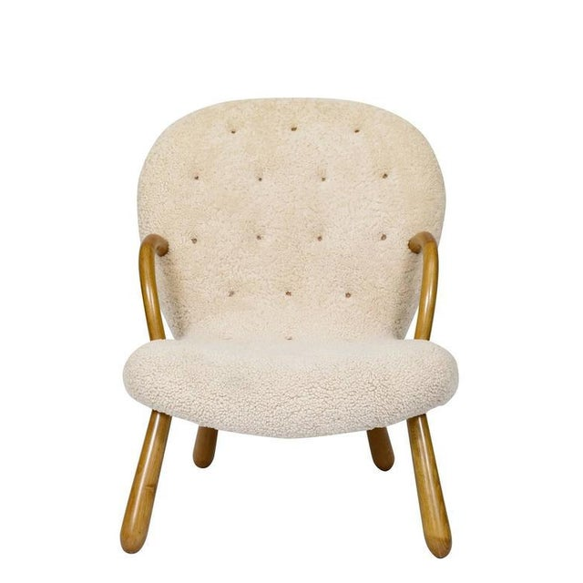 "Pair of Philip Arctander ""Clam"" chairs upholstered in sheepskin. Store formerly known as ARTFUL DODGER INC"