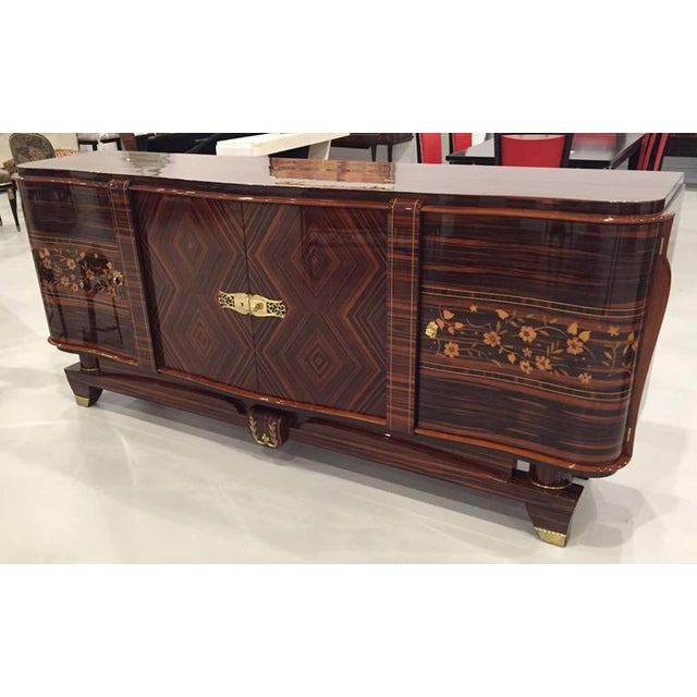"""A spectacular French Art Deco Macassar """"zigzag"""" buffet with flower motif. The brass hardware accents the buffet..."""