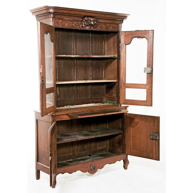 A nice early 19th century French oak cabinet also known as a buffet du corps. The crown center carved with a basket of...