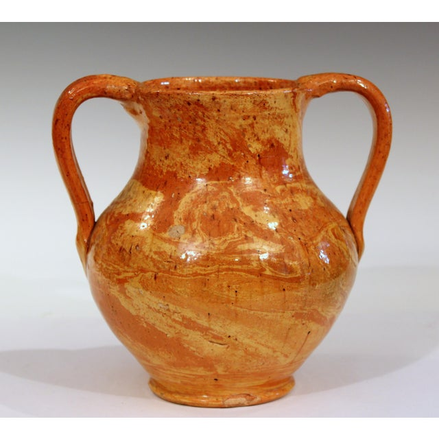 Vintage North Carolina scroddled clay agate ware vase with nice patterns and great, warm butter/terracotta colors....