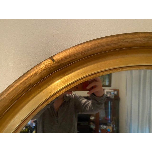 "This is a large 33"" round Hollywood Regency mirror with gold gilt wood frame. Absolutely a quality piece that would be..."