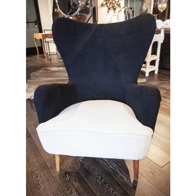 A petite multicolor club chair with a modern, contemporary feel. It's white seat cushion in chenille and wood legs welcome...
