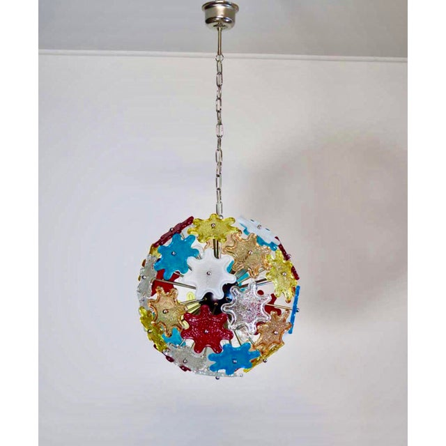 Stunning chandelier with chrome frame, painted black. 37 lovely Murano glass flowers in variety of colors; blue, orange,...