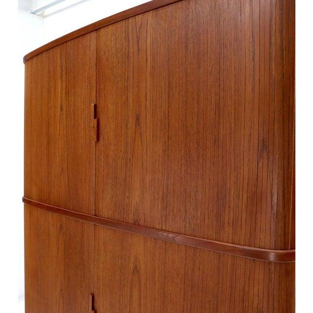 Very fine quality Danish Mid-Century Modern corner cabinet. Featuring famous Danish tambour door credenza style design...