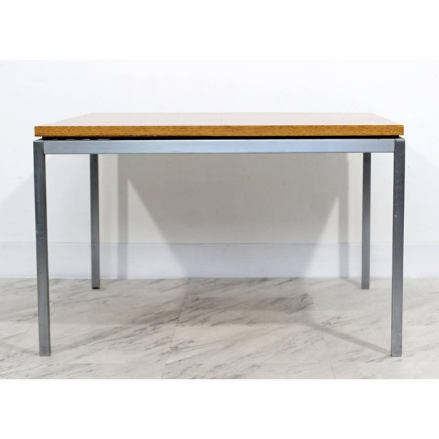 For your consideration is a early Florence Knoll sturdy, square, steel and walnut, coffee table, circa 1950s. With...