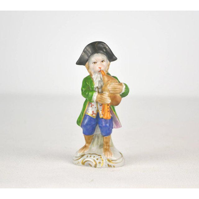 A charming porcelain monkey musician playing the bagpipe. The hand painted details are so finite and detailed. Sitzendorf,...
