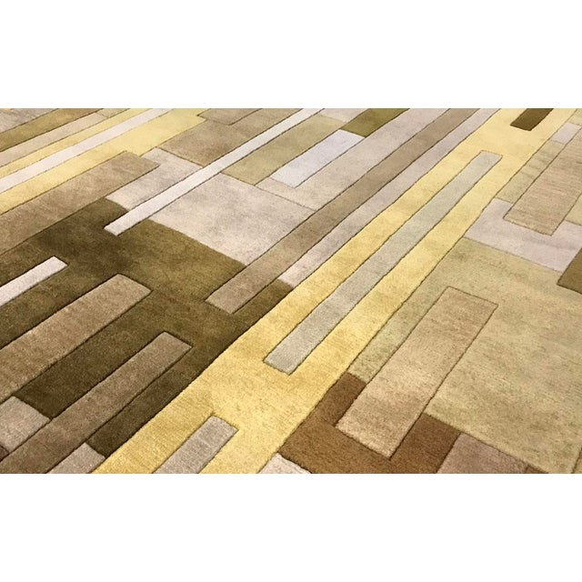 Traditional Tibetan patterns are reinterpreted in this line of contemporary designs. Each rug is hand woven in lustrous...