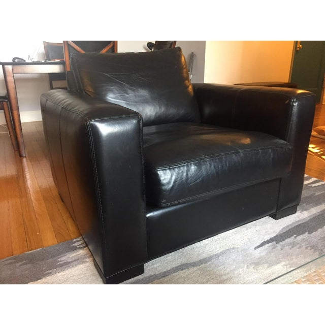 Beautiful and comfortable leather chair from Room & Board. Little use and in impeccable condition. No longer want black...